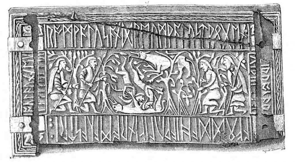 """Side of a whale's bone box from the early 8th century called """"the Franks Casket"""" showing Romulus, Remus and the she-wolf, and runes."""