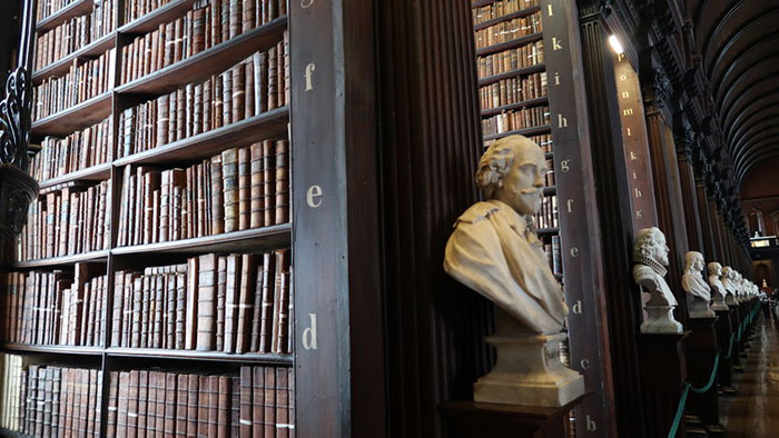 Bookshelves and marble busts in the Trinity College Library, Dublin.