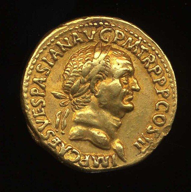 Roman gold coin with the profile of emperor Vespasianus.