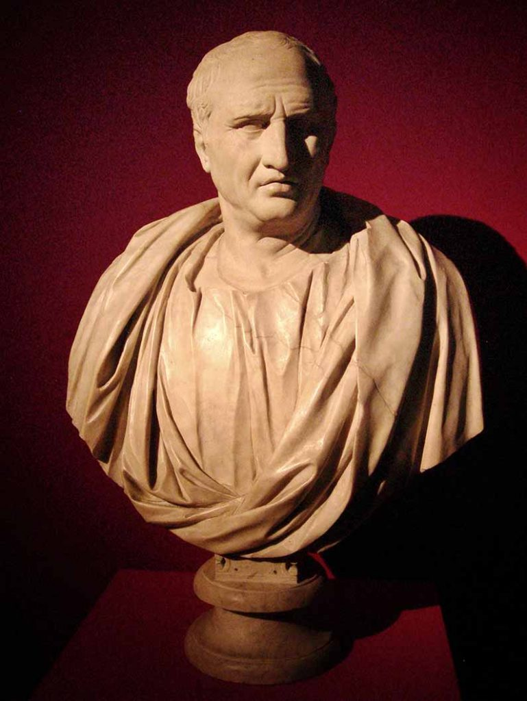 White marble bust of Cicero against a red background.