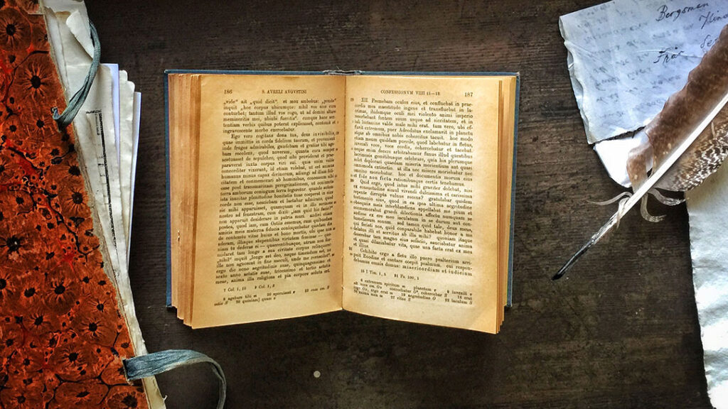 Augustinus' Confessiones in an open book on an old pulpet.