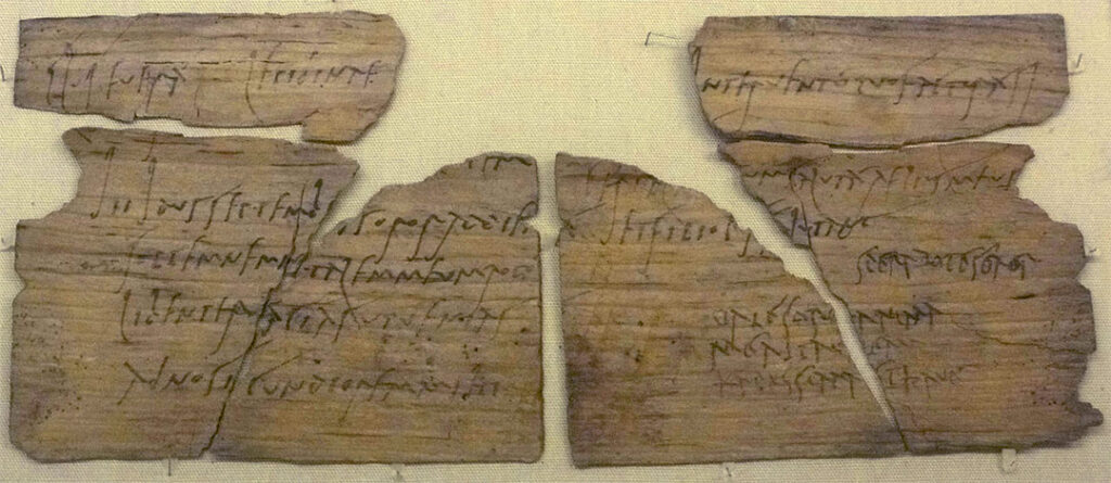 Wood writing tablet from Vindolanda with a party invitation written in ink, in two hands, from Claudia Severa to Lepidina.